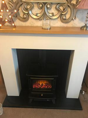 Fireplace surround with electric log burning stove