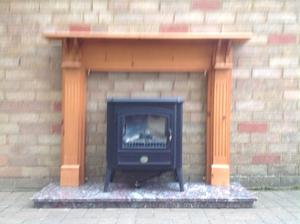 Berry log effect electric fire, wood surround and marble hearth