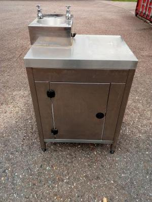 Stainless hand basin and stanless storage cupboard.