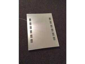 Feature bathroom mirror with illuminated side panels in