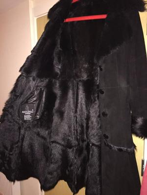 Luxurious and glamorous Women`s Black shearling 100 % Suede