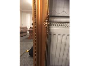 Large gold ornate leaner mirror in Chesterfield