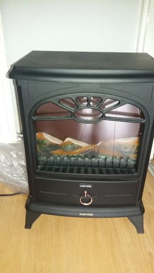 Warmlite electric log effect stove fire