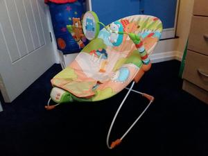 Baby bouncing chair. Vibrates and plays music. Exc. cond