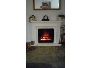 Electric log effect fire and surround in Camberley