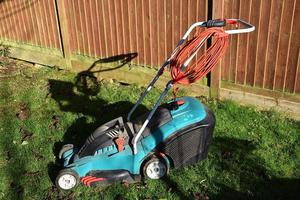 Electric rotary lawn mower.