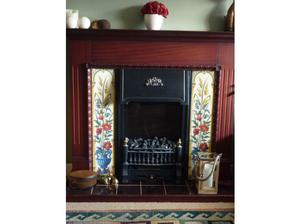 Flame effect electric fire with Victorian style mahogany