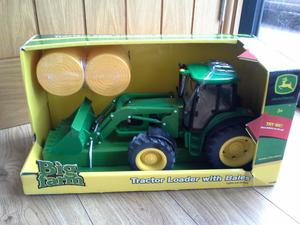 John Deere tractor and loader with bales Big Farm