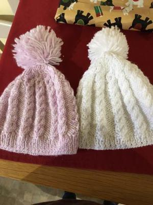 Two beautiful knitted new born hats