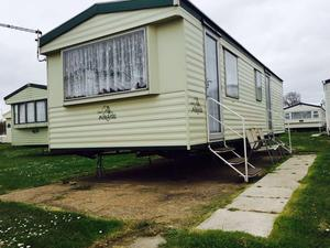 2 bed caravan £ site fees for 2 years! 5 star park
