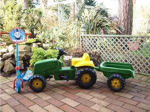 Kids ride on pedal tractor and scooter in Newport