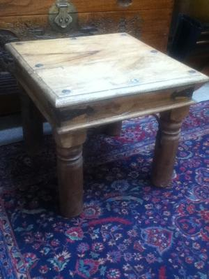 A solid wood rustic side table