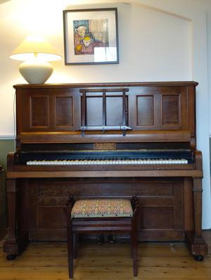 Overstrung metal frame upright piano in good condition &