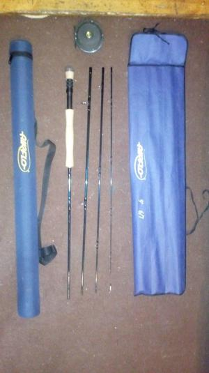 Great condition airflo fly rod 9' 6/7 four sections and reel blue rod bag and hard plastic case blue