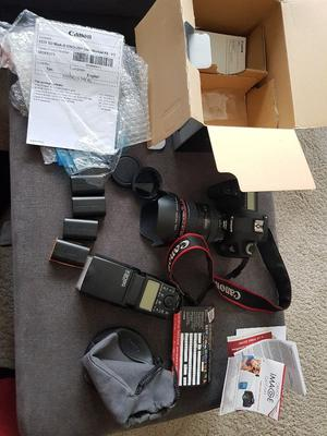 Canon 5d Mark III with a  L lense, Canon flash, 5 Bateries and more