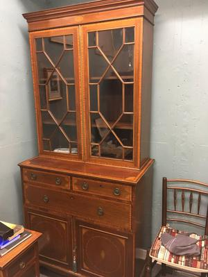 Antique mahogany and satinwood inlaid bookcase.