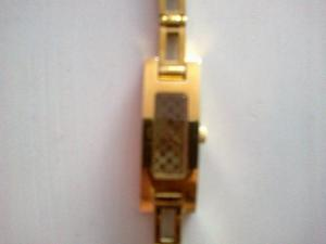 Woman's Gold Gucci watch for sale. Collection Only.
