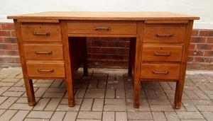 Solid oak desk with 5 drawers