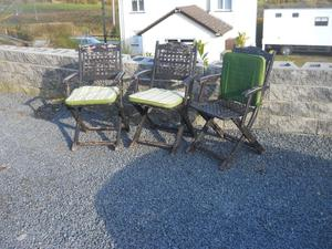 patio set and three wooden folding chairs
