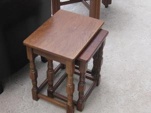 Small oak nest of tables set of two.