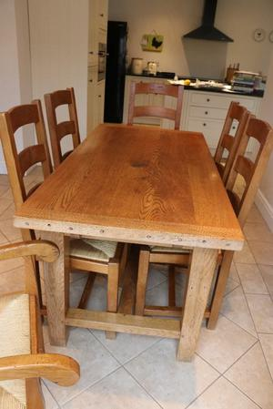 Solid oak dining table & 6 chairs (incl 2 carvers). Table 152cm (extends to 198, or 244 cm) x 76cm.
