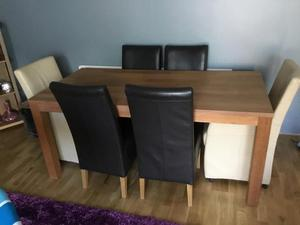 Dining table with carver chairs two and four and chairs