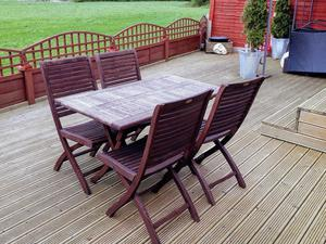 WOODEN GARDEN TABLE & 4 FOLD-ABLE CHAIRS.