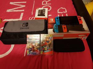 Nintendo switch like new plus 2 games2 additional controllers, charging dock for controllers and bag