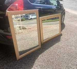 2 large gold mirrors