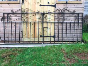 PAIR OF SOLID WROUGHT IRON GATES