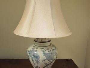Table light in a blue and white floral pattern with cream