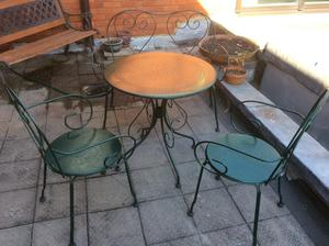 Metal garden table and two chairs and a two seater