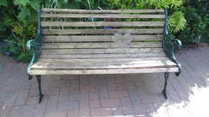 WOODEN SLATTED GARDEN BENCH WITH METAL DECORATIVE ENDS