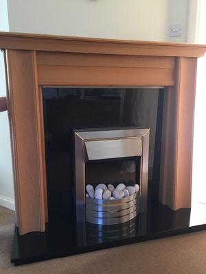 Solid oak fireplace with marble hearth