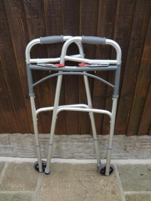 Folding adjustable walking frame with front wheels
