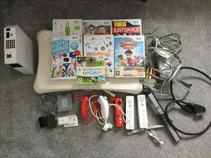 Nintendo wiii, 7 games, wii fit board, all cables and sensors