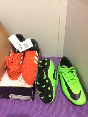 2 x kids football boots sizes: 5 and 5 ½