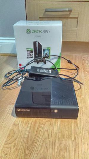 Xbox 360 console with wireless receiver and charging dock.