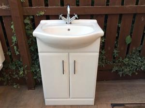 Vanity unit with basin and chrome mixer tap
