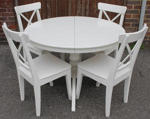 Extending White Round Table & Chairs