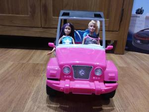 Barbie jeep and two dolls