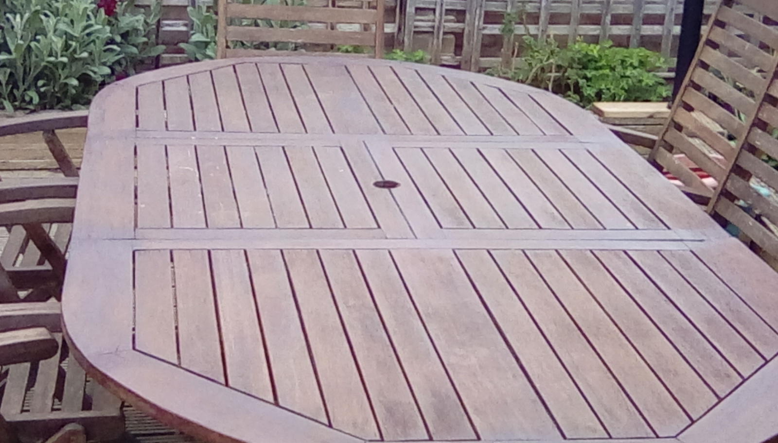 Wooden garden table and eight chairs
