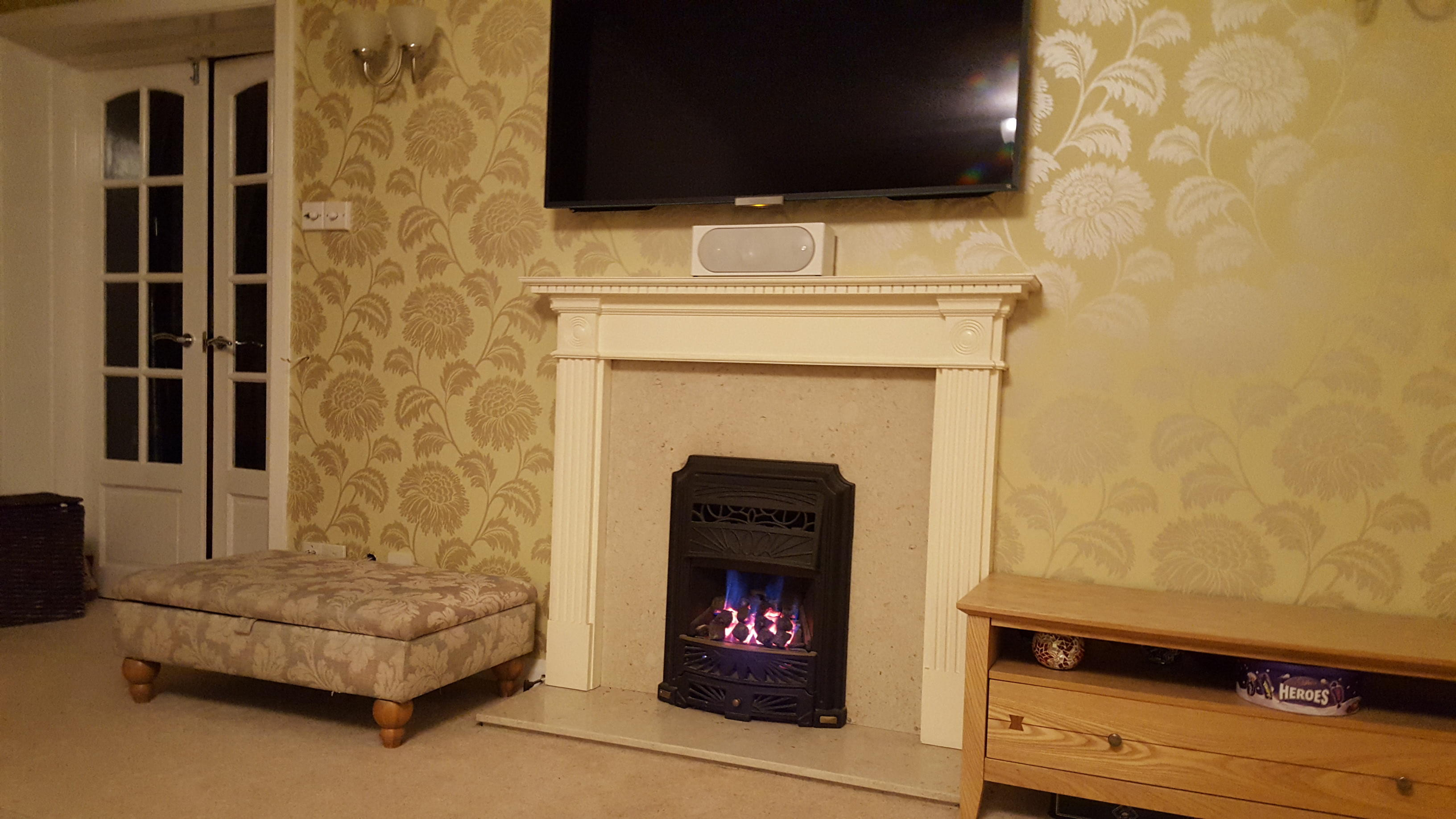 coal effect gas fire and surround