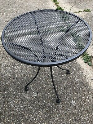 Grey latticed solid metal garden table and Two chairs From