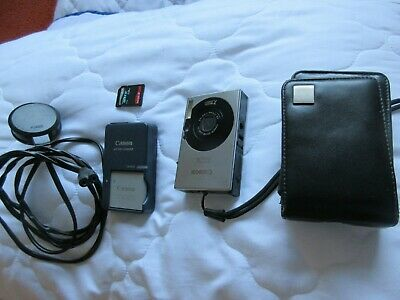 Canon IXUS 70 with case and SD card.