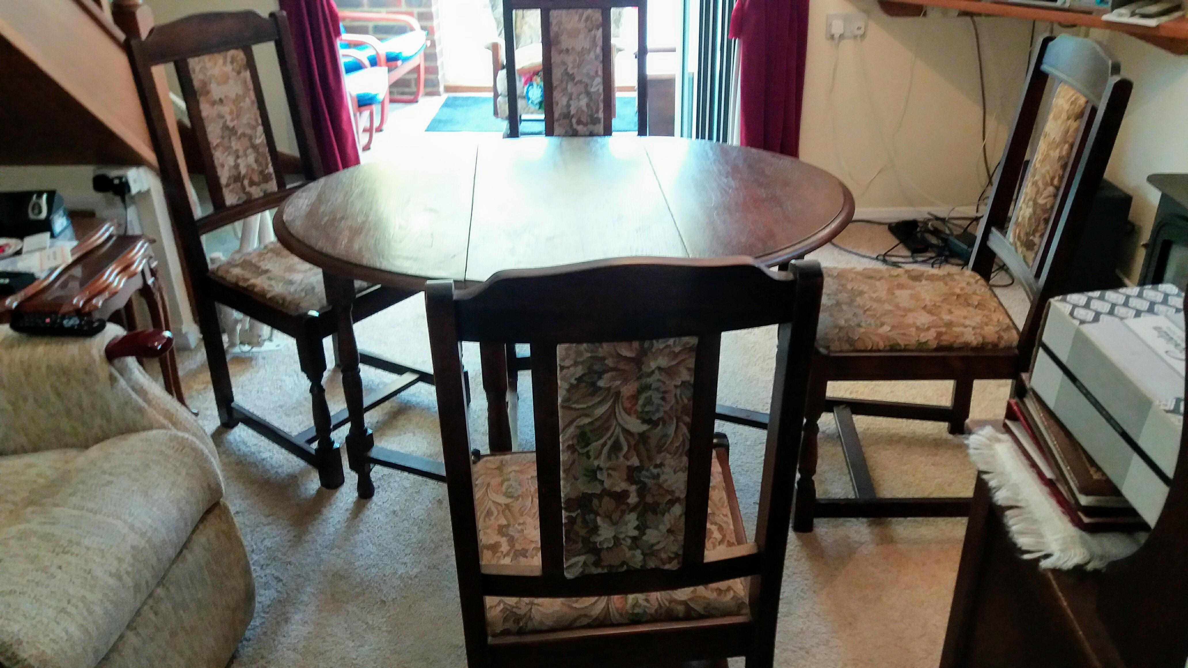Oak drop leaf table and four chairs.