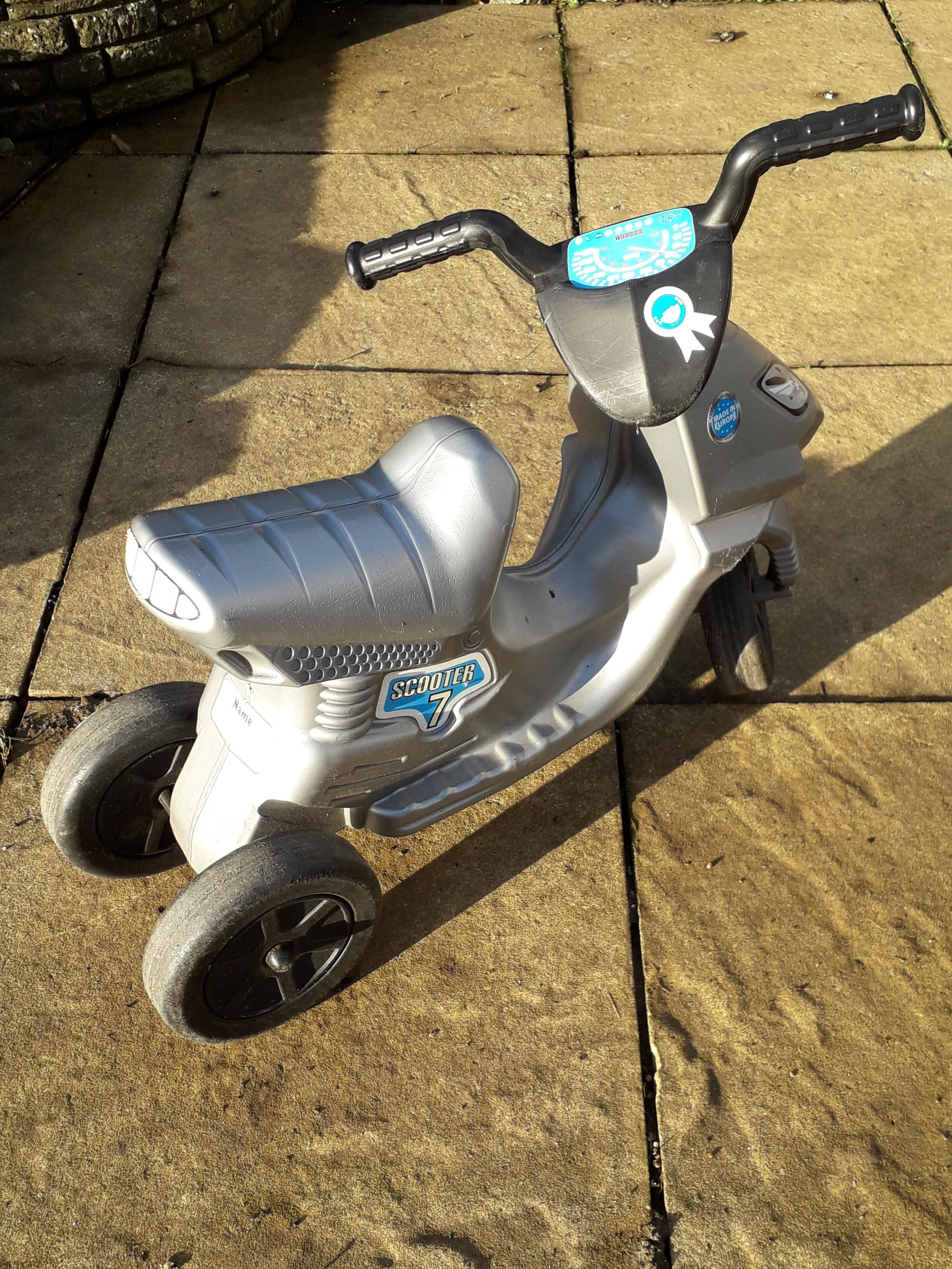 Childs sit on scooter