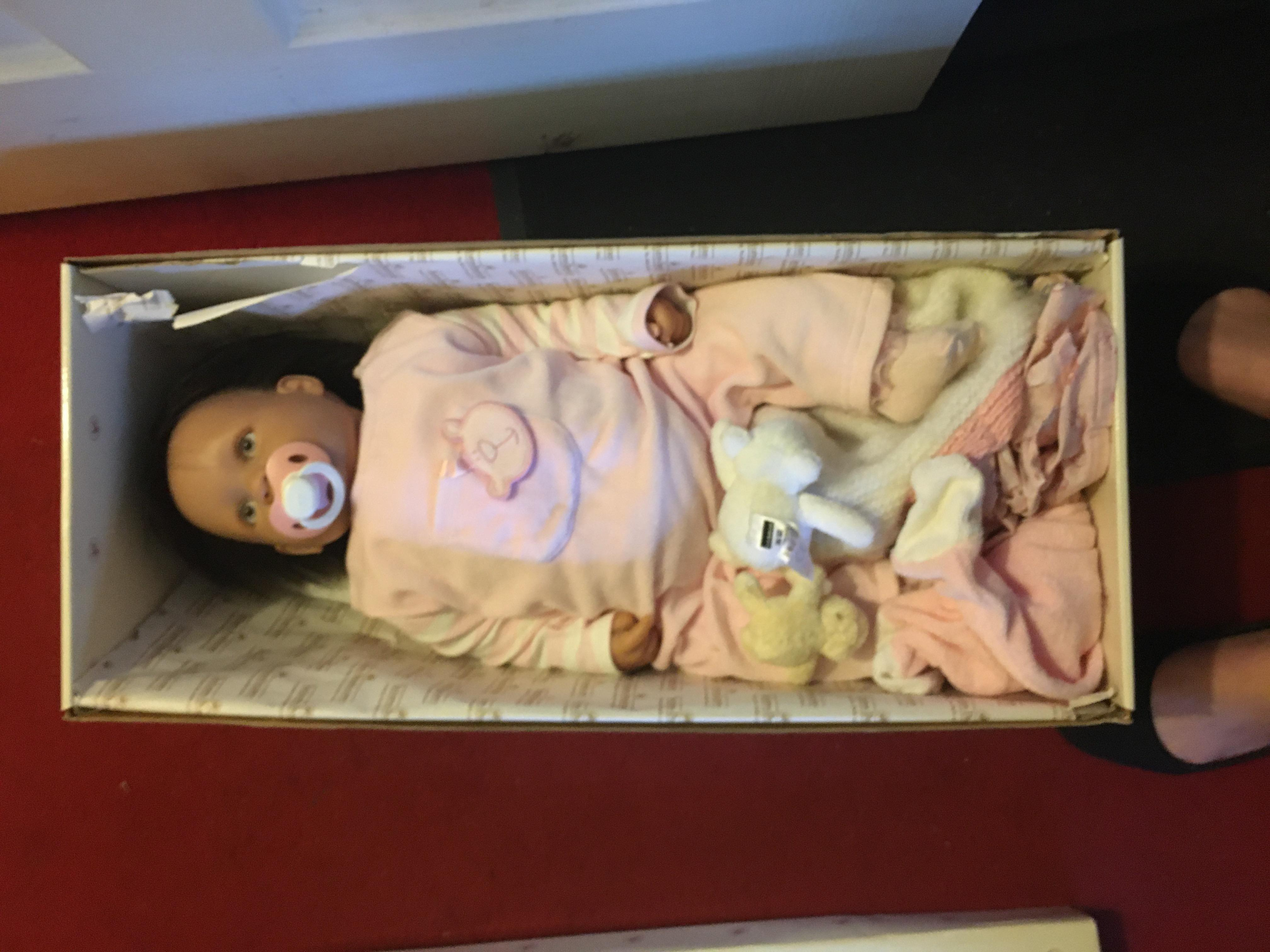 Brand new new born baby in box with accessories