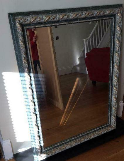 Stunning large mirror with ornamental leafy design moulded