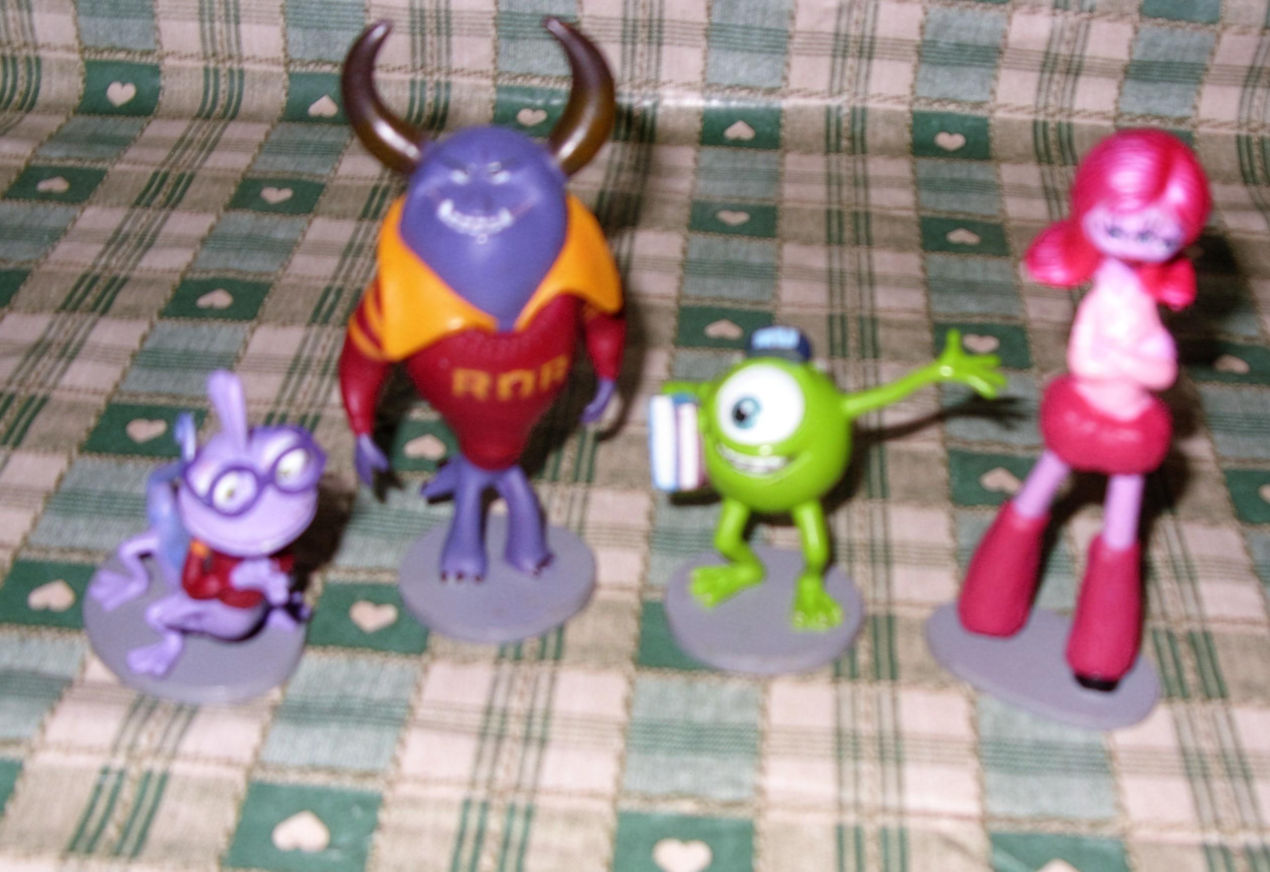 Monsters Inc x4 toys,cake toppers